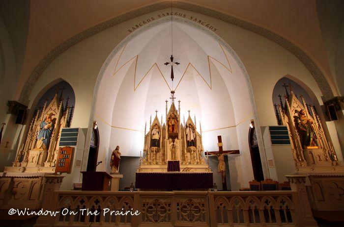 Communion rail, high altar and side altars