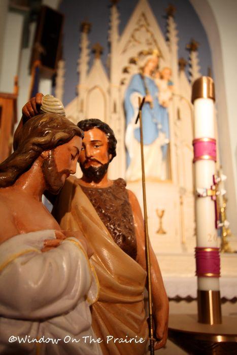 Statue atop the baptismal fount of St. John baptizing Jesus