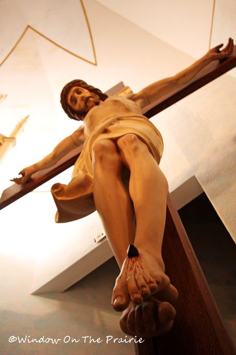 crucifix to the right of the high altar