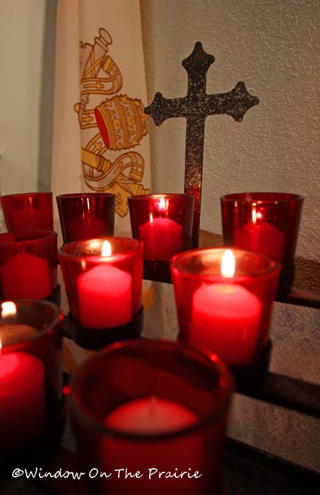 candles in front of one of the side altars