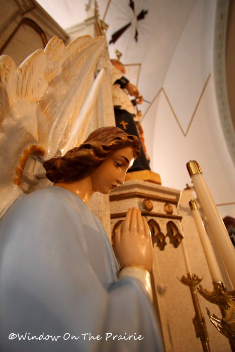 statue of angel near the high altar